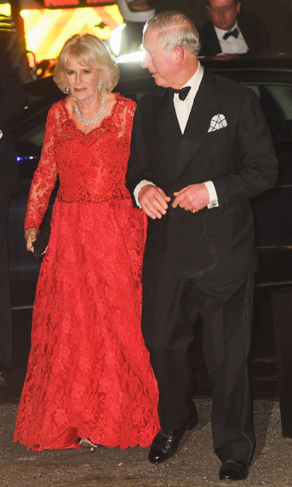 Camilla exuded heaps of glamour in a heavily embellished red lace gown.