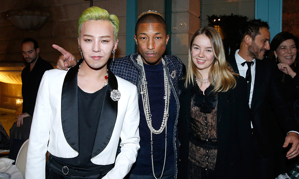 Pharrell made his runway debut for Chanel at the brand's 13th Métiers d'Art show, where the singer was clad in layers of long necklaces, one of the brand's signature coats and a small headpiece. He also rubbed shoulders with Monaco's Alexandra of Hanover.