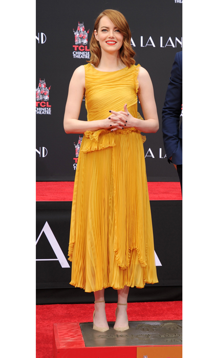 December 7: <em>La La Land</em> actress Emma Stone was a ray of sunshine wearing a Rochas dress paired with Jimmy Choo shoes at her hand and footprint ceremony held at the TCL Chinese Theatre IMAX in Hollywood, California.