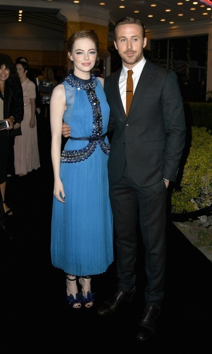 December 6: Emma Stone looked gorgeous in a blue Prada dress with Jimmy Choo shoes as she stood next to Ryan Gosling during the premiere of La La Land in Westwood, California. 