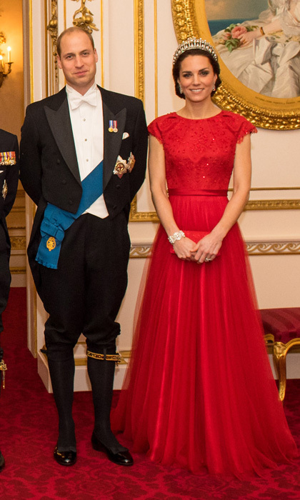 Prince William and Kate were quite the striking pair in an official portrait at the Queen's annual Diplomatic Reception. The duo posed alongside the monarch, Prince Philip, Prince Charles and Camilla, with Kate decked out in a recycled Jenny Packham gown and the Cambridge Lover's Knot tiara and her husband clad in a blue sash and knee breaches with the Order of the Garter insignia. 