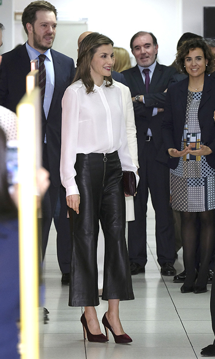 Queen Letizia of Spain looked lovely in leather during a visit to the Zeta Group building in Madrid. The royal attended the event with her husband King Felipe. 