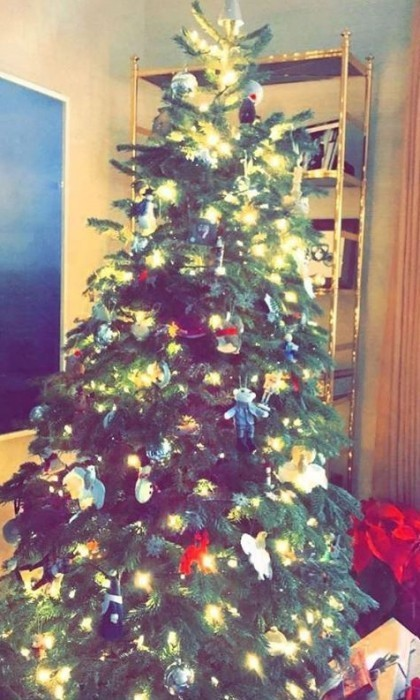 Reese Witherspoon took to Instagram to ask her followers for the best tree-trimming tips. The Draper James founder showed off her family's tree that already has some presents waiting underneath. 