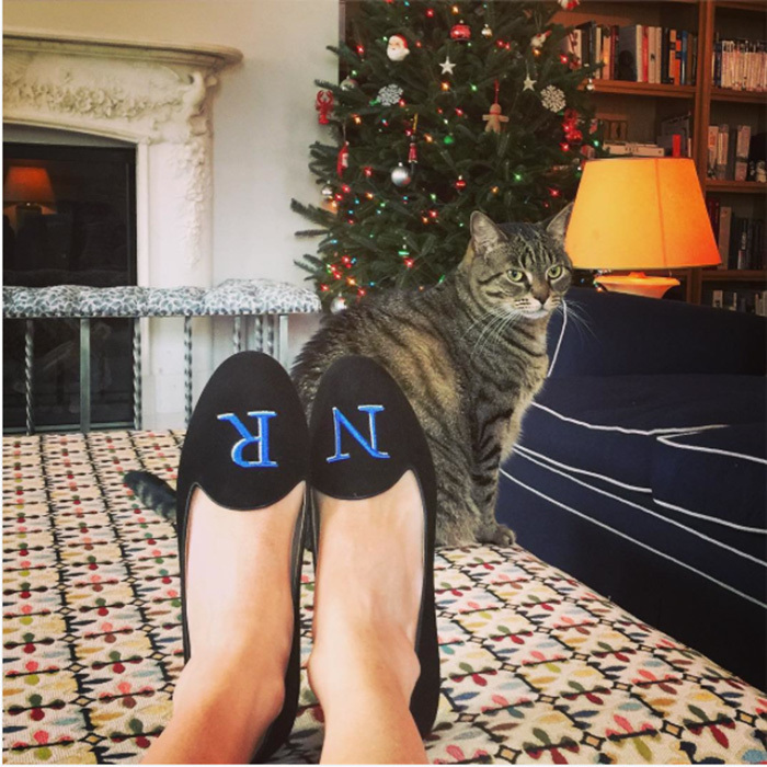 Nicky Hilton Rothschild showed off her monogrammed loafers as she chilled next to her Christmas tree (and her cat!).