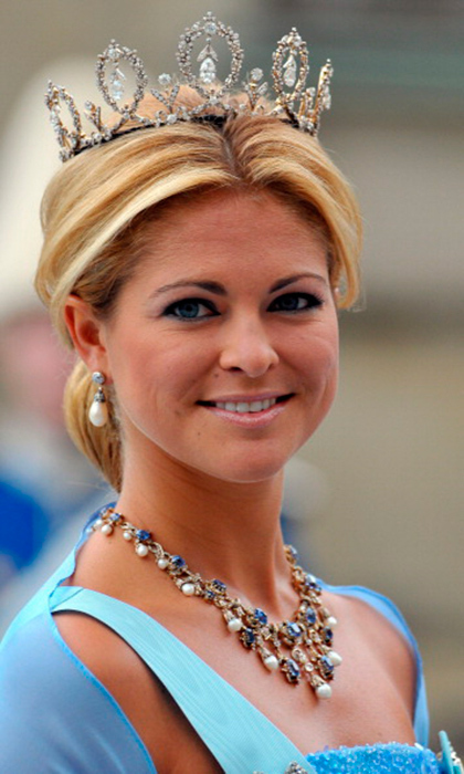 "A closer look at Princess Madeleine of Sweden wearing the Connaught ""Forget-Me-Not,"" with five loops of flowers and leaves surrounding a detachable suspended diamond pendant.