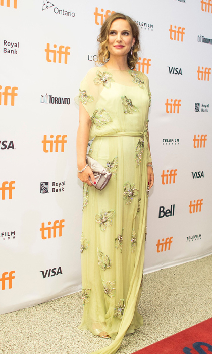 Natalie attended the 2016 Toronto International Film Festival to promote <em>Jackie</em> wearing a sunny Prada gown embellished with flowers.