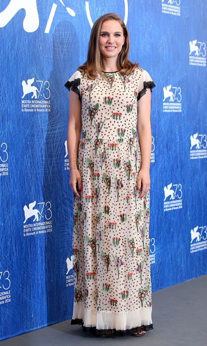 When in Venice! The <em>Jackie</em> star kept her figure under wraps during a photocall at the 2016 festival, wearing a loose-fitting gown by Red Valentino.