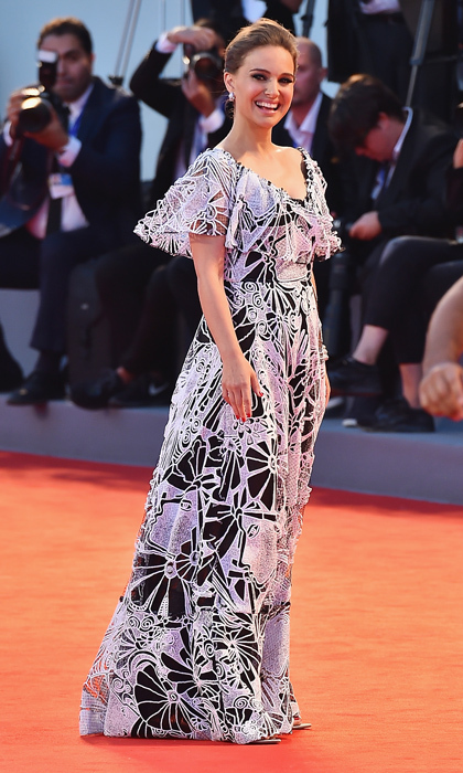 The expectant mom looked breathtaking in Valentino Resort at the 2016 Venice Film Festival thanks to her monochromatic gown's geometric pattern and flirty shoulder ruffle. 