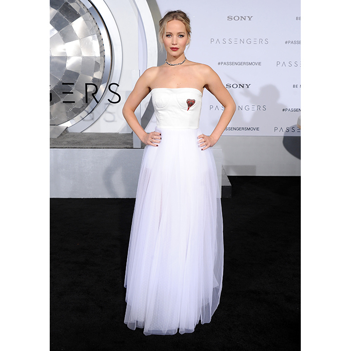 December 14: <em>Passengers</em> star Jennifer Lawrence was a vision in white Dior on the black carpet. 