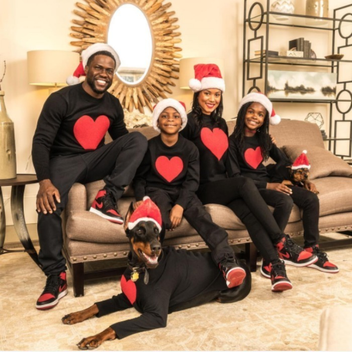Kevin Hart and his family showed off their big hearts and Santa hats for a holiday photo.