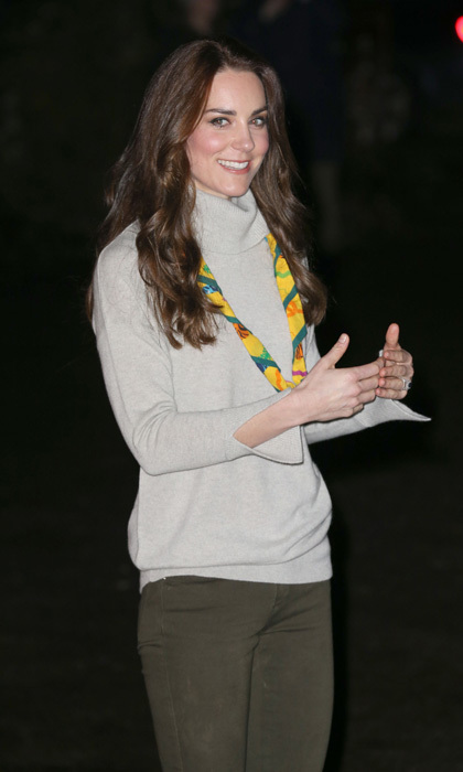 The Duchess of Cambridge looked casual in jeans and a grey sweater to meet with cub scouts from the Kings Lynn District.