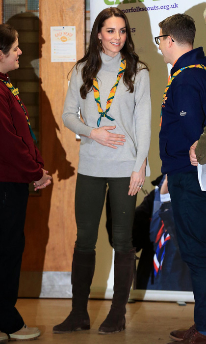 Kate, who has previously worked as a volunteer with a Cub Scout Pack, stepped out in a laid-back albeit chic look for her visit, wearing a grey cashmere turtleneck sweater by Iris and Ink, which she paired with dark trousers and her trusty Really Wild Clothing Spanish Boots. The stylish royal accessorised the outdoorsy outfit with a Cubs 100 scarf around her neck.