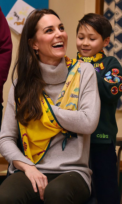 A Cub Scout used a neckerchief to show Prince George's mom how to support a broken arm during the meeting.