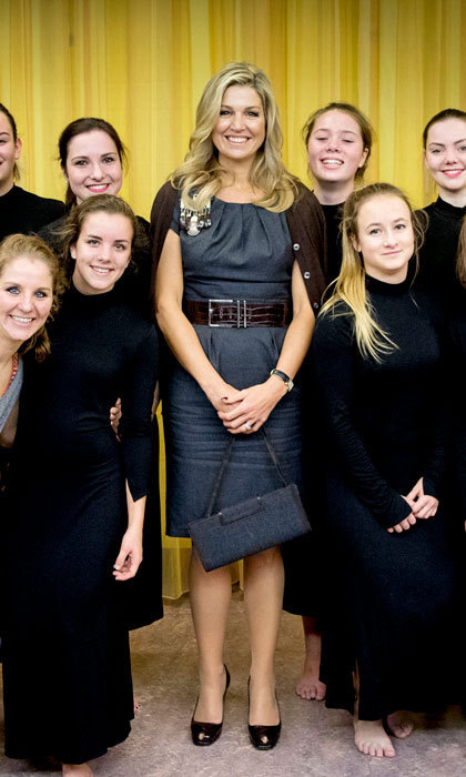 Queen Máxima showed off her style credentials wearing a Natan dress with a cardigan draped over her shoulders for her visit to the De Pracht community center.