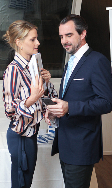 Royal foodie Princess Tatiana of Greece held her book A Taste of Greece: Recipes, Cuisine & Culture as she joined her husband Prince Nikolaos at an Athens event promoting the cookbook.