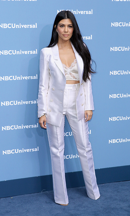 "<a href=""/tags/0/kourtney-kardashian/"" target=""_blank"">Kourtney Kardashian</a>'s suit went sexy with a white bralette under her jacket at an event in New York.<br>Photo: &copy; Getty Images"