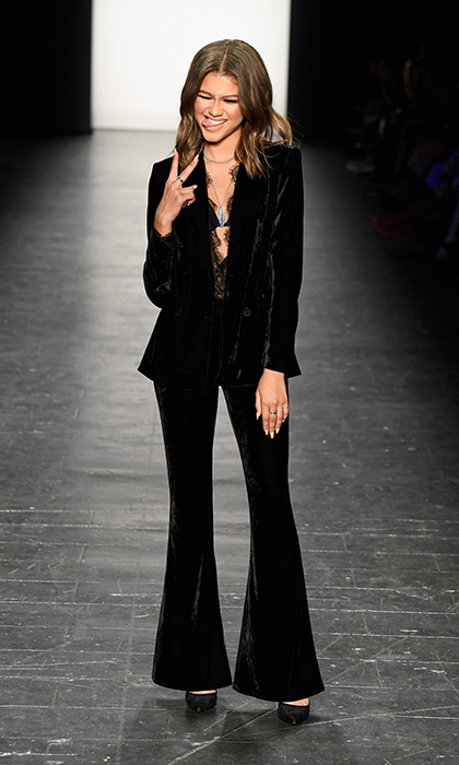 "<a href=""/tags/0/zendaya/"" target=""_blank"">Zendaya</a> modelled a velvet suit from her own collection at the Project Runway fashion show during New York Fashion Week.<br>Photo: &copy; Getty Images"