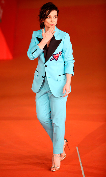 "<a href=""/tags/0/juliette-binoche/"" target=""_blank"">Juliette Binoche</a> added a pop of color to the carpet of the 2016 Rome Film Festival in a turquoise pantsuit.<br>Photo: &copy; Getty Images"