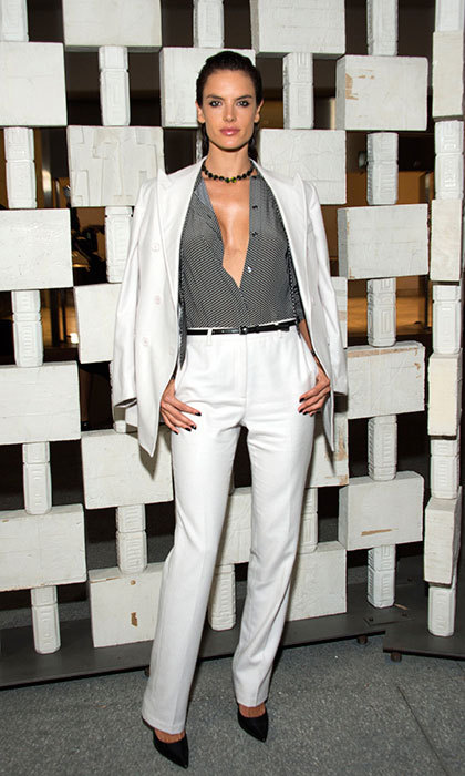 "<a href=""/tags/0/alessandra-ambrosio/"" target=""_blank"">Alessandra Ambrosio</a> showed off her fashion credentials wearing her white blazer over her shoulders at the Hammer Museum Gala in the Garden.<br>Photo: &copy; Getty Images"