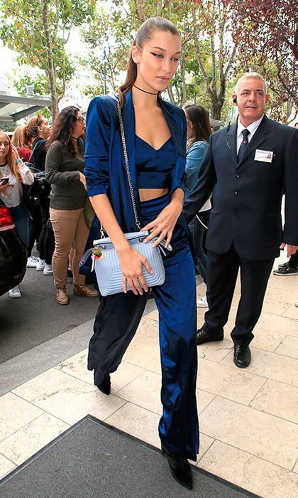 "<a href=""/tags/0/bella-hadid/"" target=""_blank"">Bella Hadid</a> turned the streets of Milan into her personal runway, stepping out in a blue House of Harlow satin pantsuit.