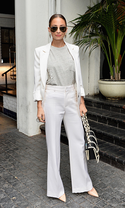 "<a href=""/tags/0/nicole-richie/"" target=""_blank"">Nicole Richie</a> looked polished sporting a white jacket and matching high-waisted trousers to the CFDA/Vogue Fashion Fund Show and Tea held at the Chateau Marmont in Los Angeles.