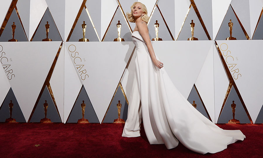 Lady Gaga turned up the glamour in a custom Brandon Maxwell gown-suit at the Oscars. 