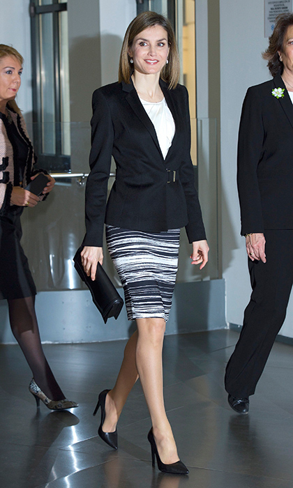 Queen Letizia of Spain wore her favourite striped BOSS Hugo Boss skirt at the Forum Against Cancer in Madrid.