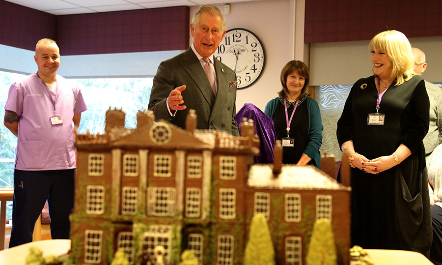 Prince Charles delivered a chocolate cake replica of his Highgrove Estate during a festive visit to The Ayrshire Hospice in Ayr.