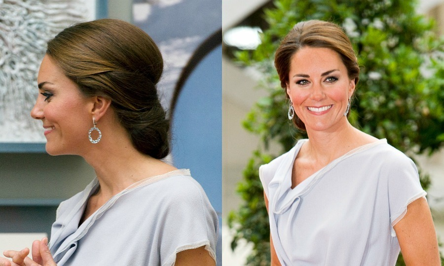 The British royal highlighted the asymmetrical neckline of her Roksanda Ilincic dress by wearing her blown-out hair up in a stylish, low-hanging chignon.
