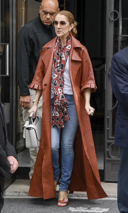 The 48-year-old elevated 'jeans and a t-shirt' to fashionable new heights by wearing a burnt orange Off-White leather coat, vintage shades and a patterned Chloe scarf. 