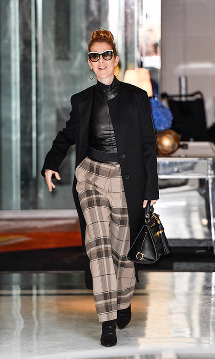 The songstress got a jump start on fall fashion when she stepped out in plaid pants, a leather turtleneck and black overcoat. 