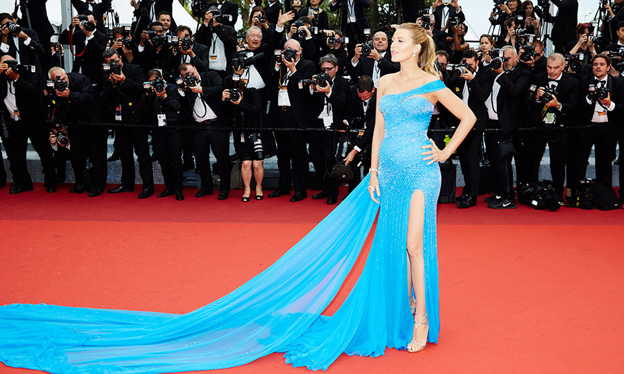 Blake Lively displayed her award-winning maternity style on the red carpet in Cannes. She donned this fitted aqua blue Atelier Versace gown (complete with thigh-high slit) at the <em>BFG </em>premiere. 