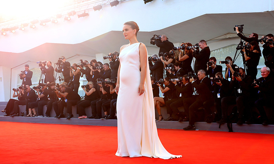 <em>Jackie</em> star Natalie Portman debuted her baby bump in a one-shoulder Christian Dior gown at the Venice Film Festival. It's the Oscar winner's second child with choreographer husband Benjamin Millepied.