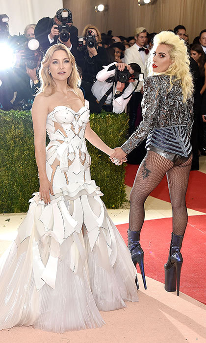 Kate Hudson stunned in all-white Atelier Versace on the Met Gala red carpet – and shared a photo-op with longtime friend Lady Gaga, who rocked sky-high heels. 