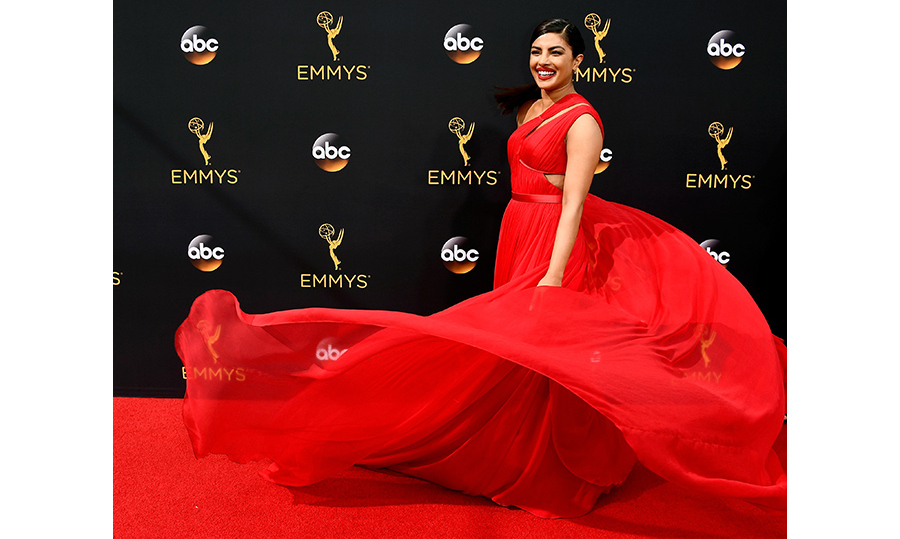 Priyanka Chopra twirled to perfection on the Emmys red carpet in a billowing crimson Jason Wu gown.