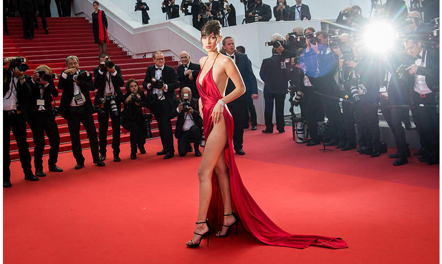 "This year's breakout ""It"" model Bella Hadid had a bombshell moment in a crimson Alexandre Vauthier Couture silk wrap gown at Cannes. 