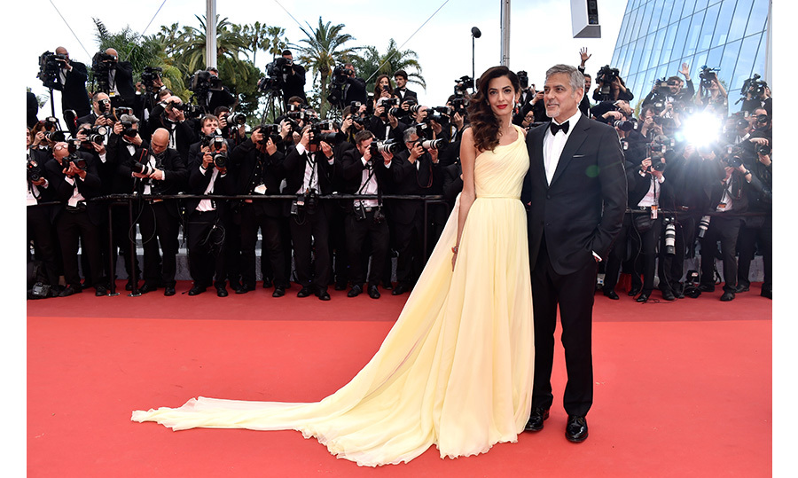 All eyes were on Amal Clooney in buttercream yellow Versace at the premiere of <em>Money Monster</em> at Cannes. The human rights lawyer made a stunning debut on the famed Palais steps with husband George by her side. 