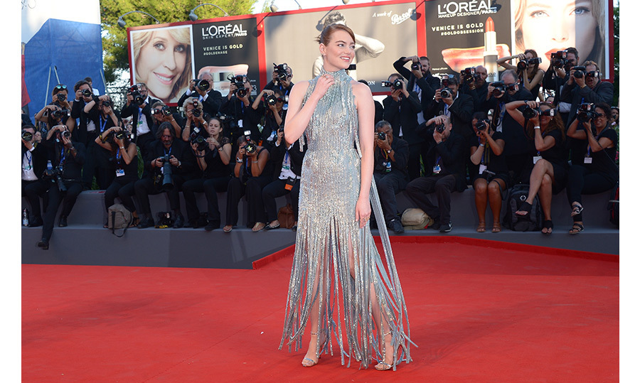 Emma Stone showed off her haute fringe appeal – and dazzling star power! – in a sequined Versace gown at the premiere of <em>La La Land</em> during the opening night of the Venice Film Festival.