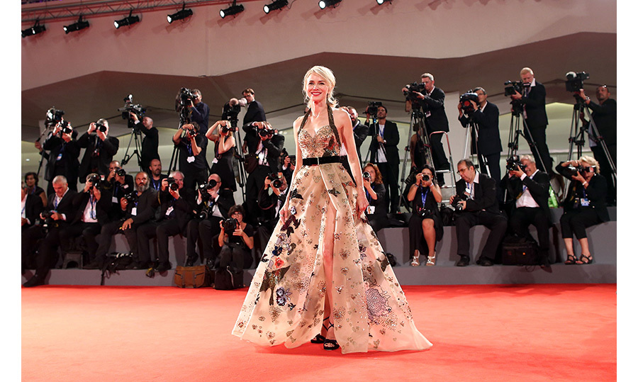 Naomi Watts sparkled in sheer Elie Saab Couture at the <em>The Bleeder</em> premiere during the Venice Film Festival. The stunning gown featured a smattering of gold sequins and floral embellishments.