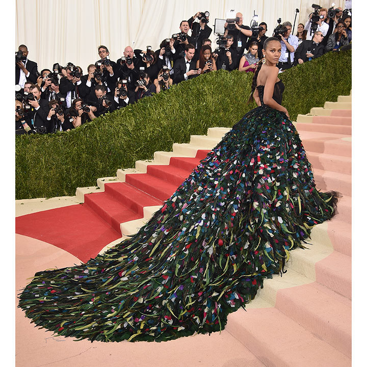 Zoe Saldana turned heads at the Met Gala as she arrived in a feathered Dolce & Gabbana gown with a dramatic train that cascaded down the museum's iconic steps. It was a major fashion moment for the <em>Star Trek Beyond</em> actress, who rocked the 3-D look to fit in with the evening's Manus x Machina: Fashion in an Age of Technology theme.