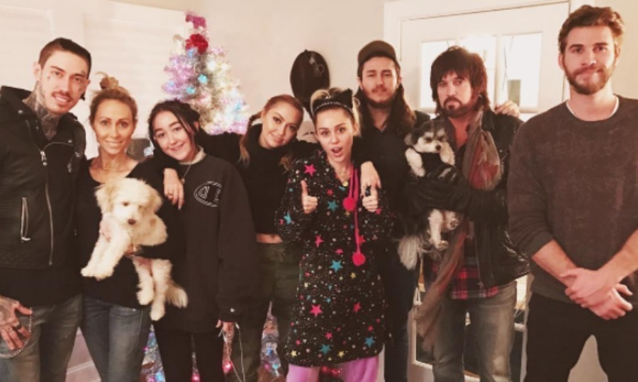 "A very Cyrus Christmas! Liam Hemsworth celebrated the holidays early with girlfriend Miley Cyrus and her family. The group (from left to right: Trace, Tish, Noah, Brandi, Miley, Braison, Billy Ray and Liam) posed for the family portrait in front of a coluorful Christmas tree. Attached to the picture, Brandi Cyrus wrote, ""Cyrus fam Christmas in full swing."" 