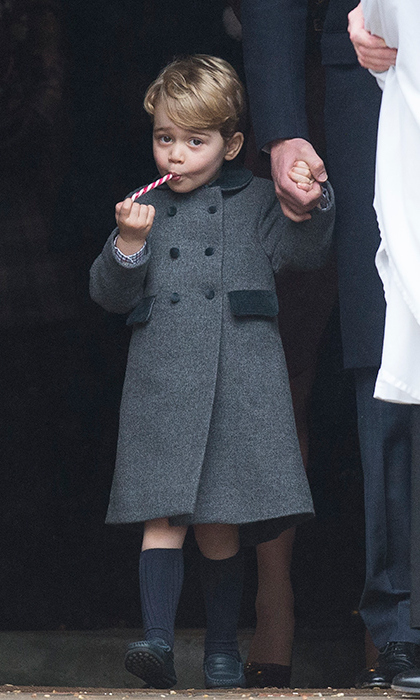 Prince George munched on a candy cane at church with his parents, Princess Charlotte and the Middletons on Christmas Day.