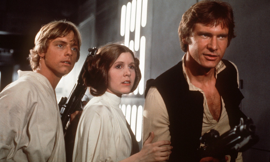 The Hollywood star's big break came in 1977 when Carrie (pictured with co-stars Mark Hamill, left, and Harrison Ford, right) took on her iconic role as Princess Leia in the hit sci-fi franchise <em>Star Wars</em>.