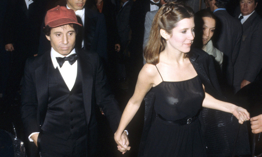 "Carrie married Paul Simon in 1983, but divorced the musician a year later in 1984. Discussing her failed marriage with <em>Rolling Stone</em> in 2016, she admitted, ""I'm not good at relationships. I'm not cooperative enough. I couldn't give him the peace that he needed,"" Carrie explained. ""We both had very interesting fights. It's all a shame, because he and I were very good together in the ways that we were good. But like I said, I don't supply someone with a really peaceful home.""