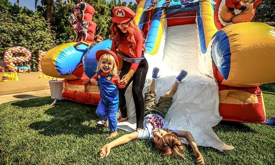 Christina Aguilera threw the best Super Mario-themed birthday party for her two-year-old daughter Summer, complete with matching Mario and Luigi outfits and a bouncy slide. 