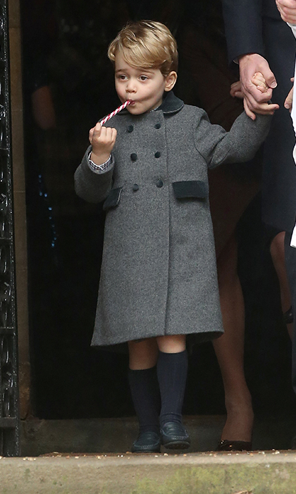 Prince George loved the candy cane he received at church on Christmas day.  