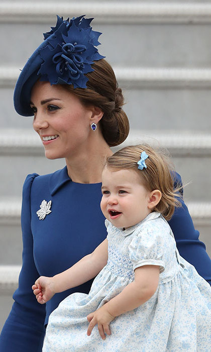 In September 2016, Princess Charlotte set off on her first tour at the tender age of one. The little royal joined her family on a 10-day visit to Canada. Charlotte arrived in Victoria looking as cute as can be in a pretty blue floral dress with navy shoes and a matching hair bow. 