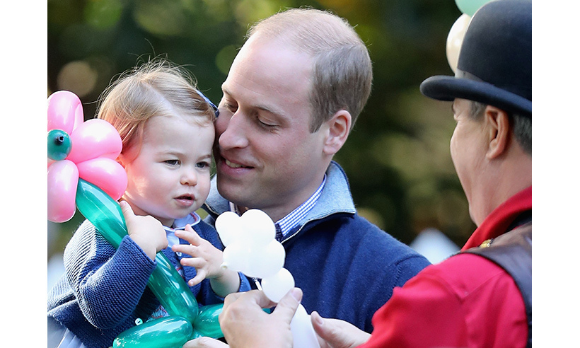 Charlotte enjoyed some daddy-and-daughter time with Prince William at a children's party in Victoria.