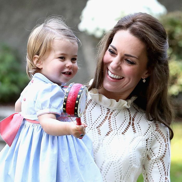 Princess Charlotte showed off her musical side at a children's party in Victoria, British Columbia. When she wasn't busy making music with her mom, the toddler was making new furry friends and playing with balloons. 
