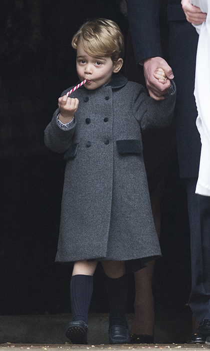 Prince George couldn't wait to get started on his candy cane after celebrating Christmas with his family and parishioners at church in Buckleberry. 